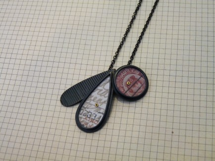"Pendant with linear raindrop, postcard raindrop + red stamp circle (19"" long) was £146 / now £70"
